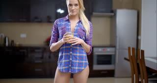 Sexy Bottomless Woman Drinking Orange Juice