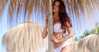 Sexy Brunette Girl Standing Under Beach Umbrella