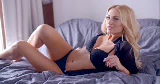 Sexy Female in Black Underwear Posing on her Bed