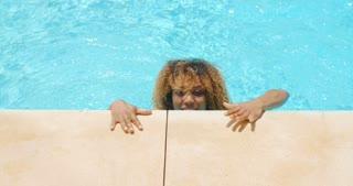 Sexy Girl in Bikini Coming Out From Pool