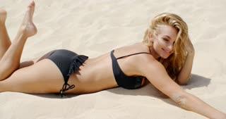 Sexy Girl in Black Bikini on the Beach