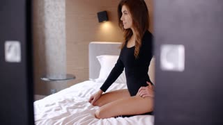 Sexy Girl in Black Bodysuit on Bed