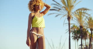 Sexy Girl with Afro Haircut Taking Sun Light