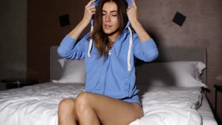 Sexy Sporty Girl in Hooded Sweatshirt at Bedroom