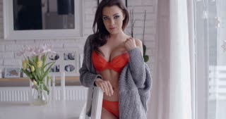 Sexy Woman in Orange Underwear with Cardigan