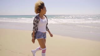 Sexy Woman Walks Beach Along