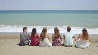 Six young people sitting overlooking the ocean