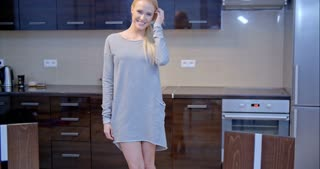Smiling Blond Woman Posing at the Kitchen