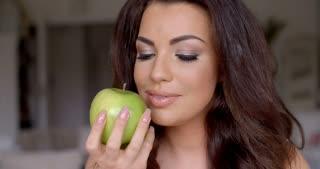 Smiling Pretty Woman Holding Fresh Green Apple