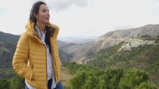 Smiling woman appreciating the peace of nature