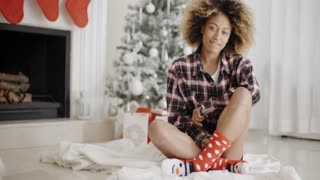 Smiling young woman in a Christmas living room