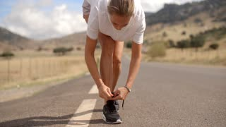 Sporty Girl Ties Her Shoe Before Run, Slow Motion Video