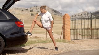 Sporty Woman Stretchs Out Before Run, Slow Motion Video