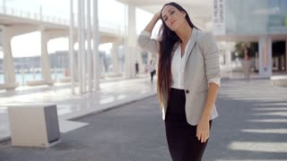 Stylish woman with long hair standing on a mobile