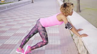 Supple athletic woman doing stretching exercises