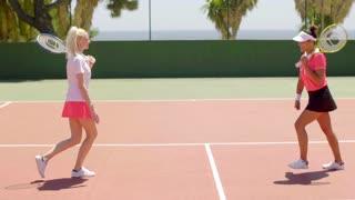 Tennis partners running to congratulate each other
