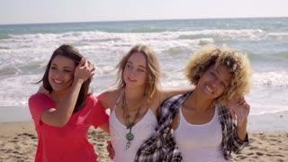 Three happy vivacious multiracial girl friends