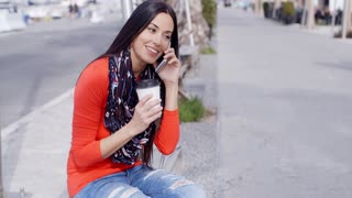 Trendy chic young woman listening to a mobile call