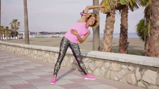 Trendy young woman doing aerobics exercises