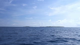 Tropical island, view from riding boat