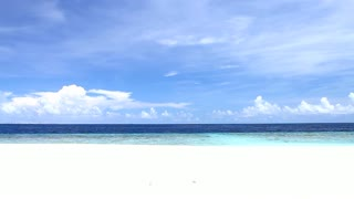 Tropical Paradise at Maldives with white beach and blue sky