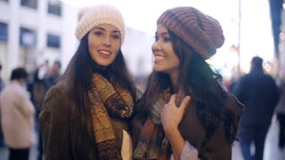 Two stylish young women in winter fashion