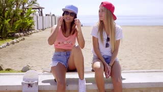 Two trendy young women with skateboards