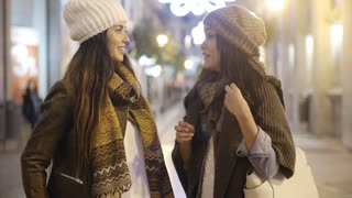 Two women chatting in a street in winter