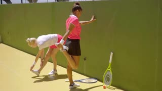 Two women warming up before playing tennis