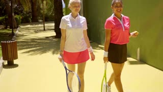 Two young woman friends at the tennis club