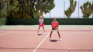 Two young woman tennis doubles players