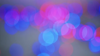 Abstract background of various colorful bright lights glowing and shining together in blur.