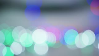 Abstract view of various glowing lights of blue and pink colors shining in dark creating unfocused blinks.