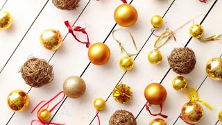Christmas golden collection, balls and decorative ornaments, on white wooden background.