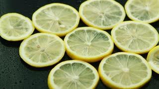 Closeup circle slices of fresh lemon on dark background