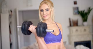Vivacious pretty blond working out