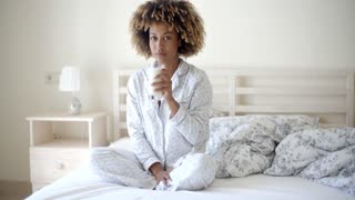 Woman Drinking A Milk On Bed