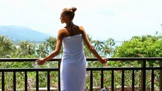 Woman enjoying view from terrace