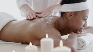 Woman Getting A Salt Scrub Treatment