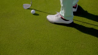 Woman golfer wearing golfing shoes