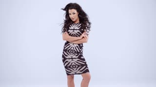 Woman in Printed Dress Against Gray Background