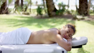 Woman in towel laying on massage table