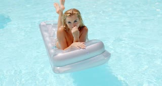 Woman Lying on Floating Mattress in the Pool