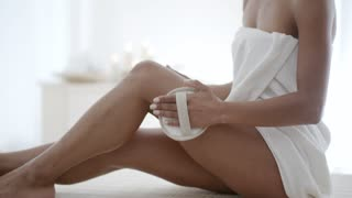 Woman Massaging Leg In Spa