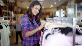 Woman Near Rack With Clothes