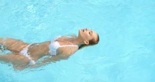 Woman Swimming on Back in Pool