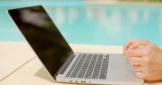 Woman using laptop computer outdoors