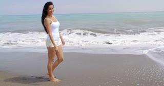 Woman Walking Along Shore of Tropical Beach