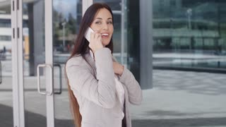 Woman with big smile on phone