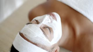 Woman With Facial Mask At Salon